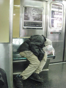 Homeless Person sleeping on NYC subway. Photo by  edkohler