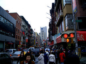 Looking south in the evening from intersection of Mott Street and Canal Street (Manhattan) in Chinatown, Manhattan. Photo credit: Chensiyuan